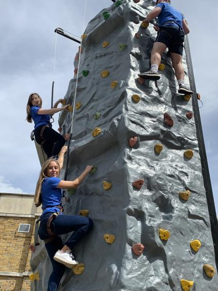 A group or climbers making their way to the top of the Climbing Wall