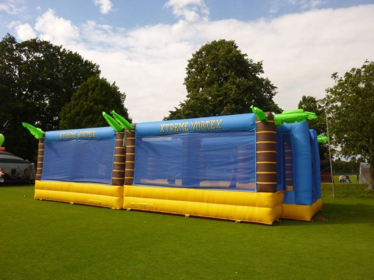 Inflatable sports arena set up on a field at a family fun day.