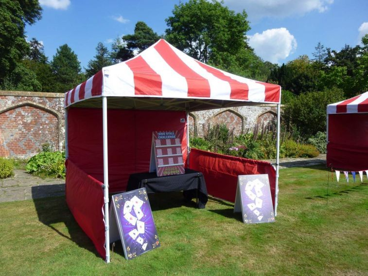 Gazebo with giant Higher or Lower traditional side stall game.