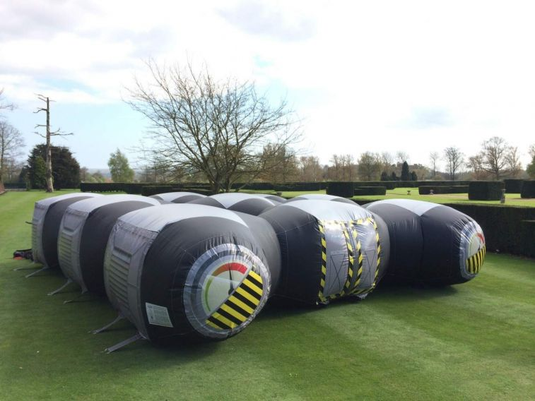 Laser Tag dome is an inflatable game which is set up on a lawn at a manor hour for a corporate team building day.
