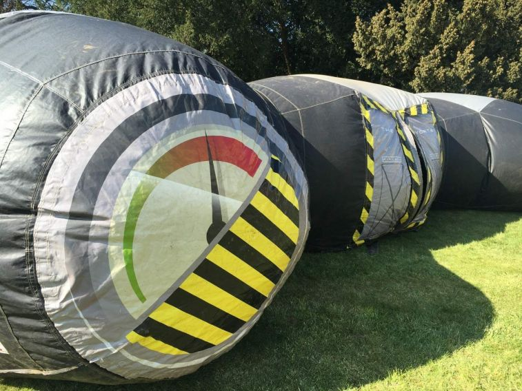 Inflatable Laser Tag arena which is a dome shaped game where players enter a central door into a darkened arena.