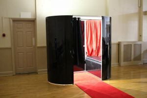 Black coloured photo booth set up for an event