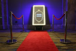Selfie Mirror Photo Booth with red carpet and Led lights on a the mirror frame.