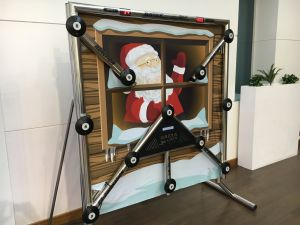 Batak Reaction Wall with Christmas themed backdrop with Santa waving