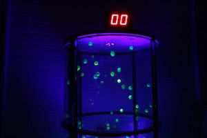 UV Grabber Game with Yellow Balls