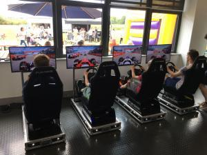 Players racing against each other on the Car Racing Simulators